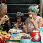Carolyn Maya and Kitty eating cakes